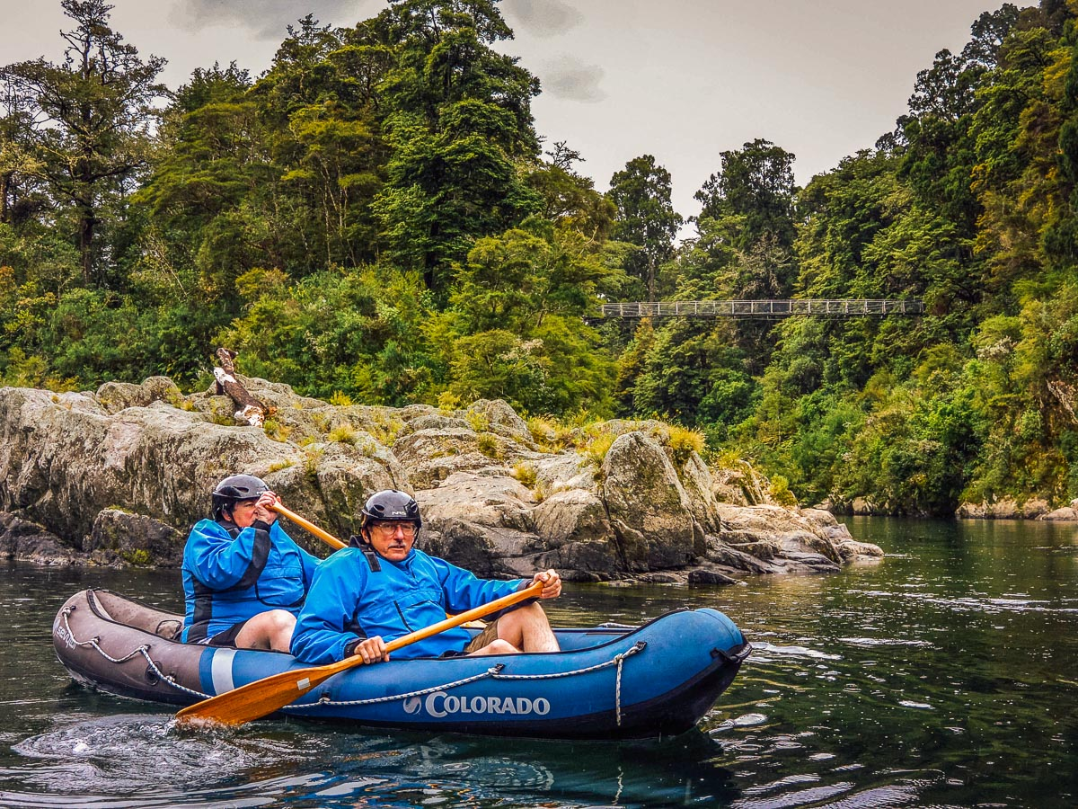 Couple kayaking at the Pelorus river, NZ