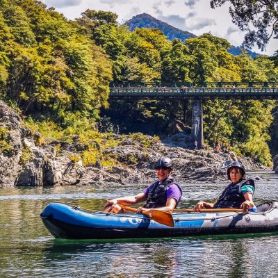 Couple having a kayaking tour in New Zealand