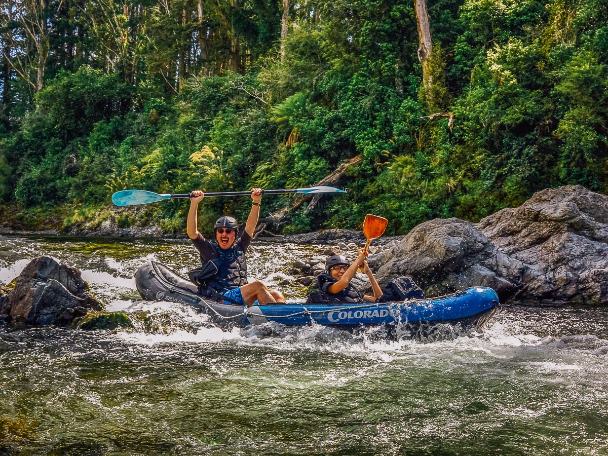 Couple kayaking rapids at the Pelorus river
