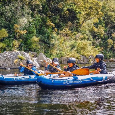Family having fun kayaking at the Pelorus river