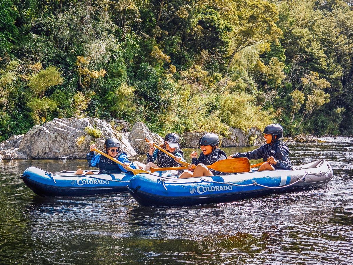 Family having fun kayaking at the Pelorus river