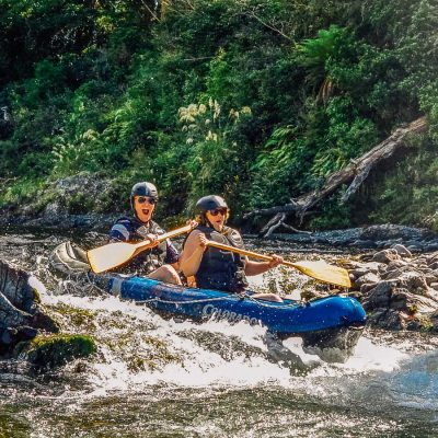 Friends kayaking rapids at the Pelorus river