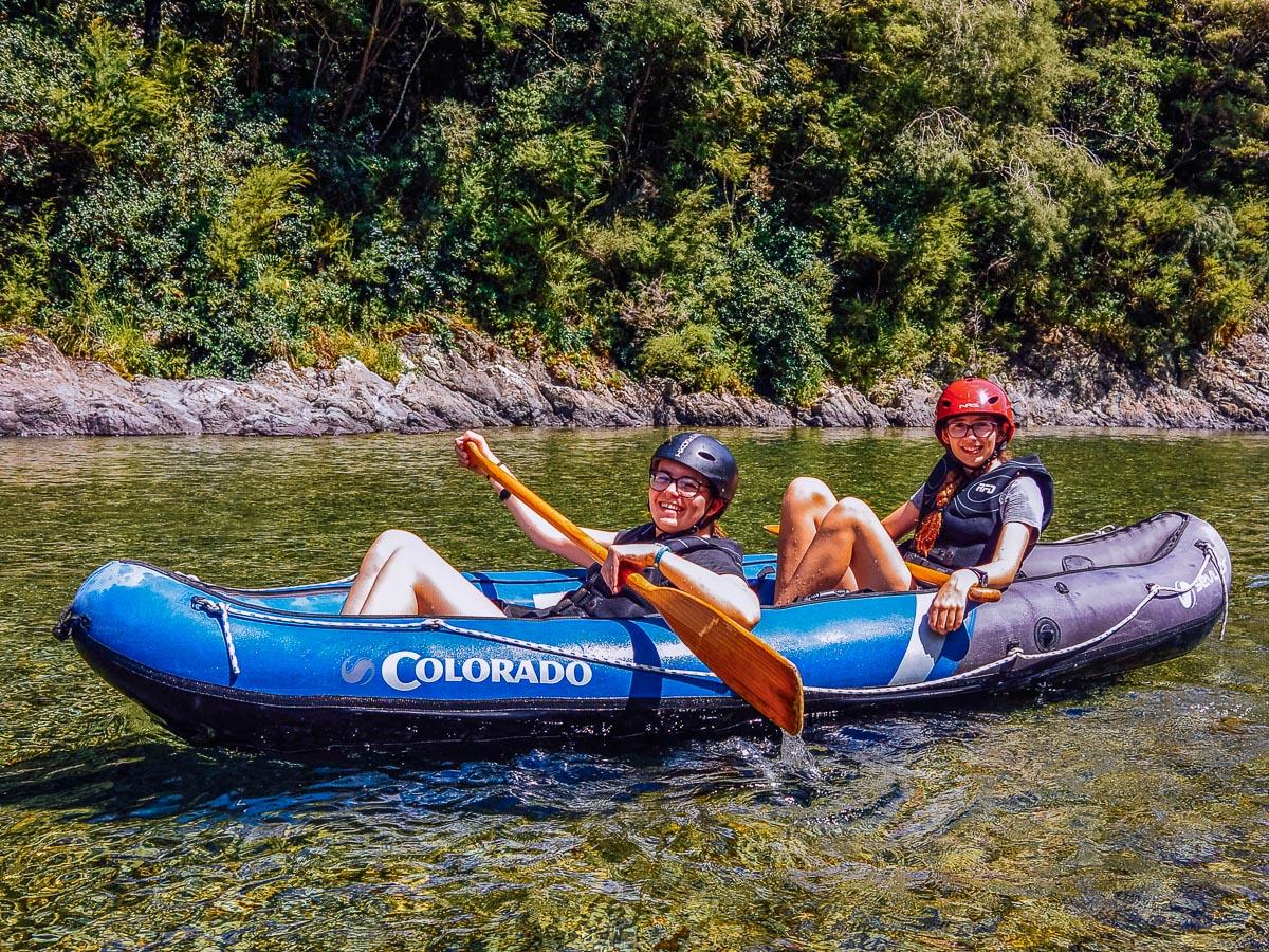 Happy friends kayaking in New Zealand