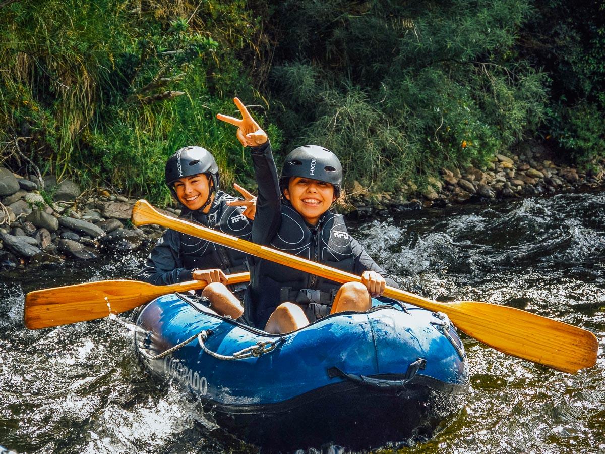 Happy kids kayaking in New Zealand