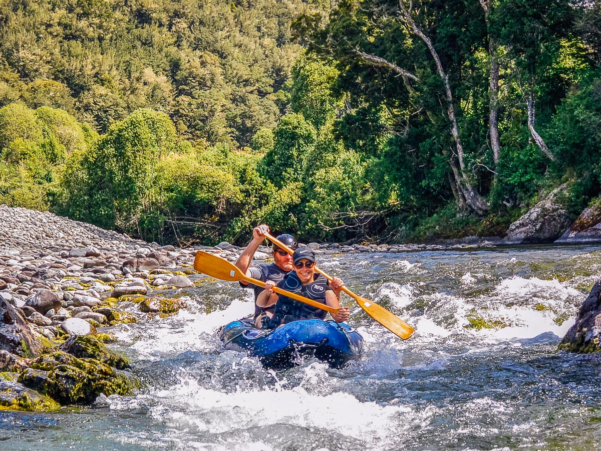 Couple Kayaking the Pelorus river, NZ