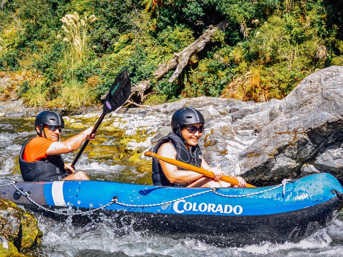Couple kayaking rapids at the Pelorus river
