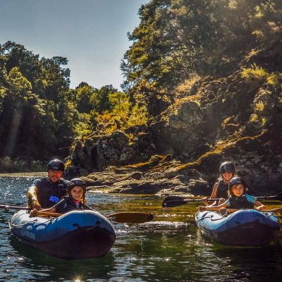 Happy family kayaking at the Pelorus river