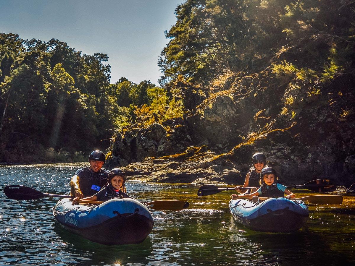 Happy family kayaking at the Pelorus river