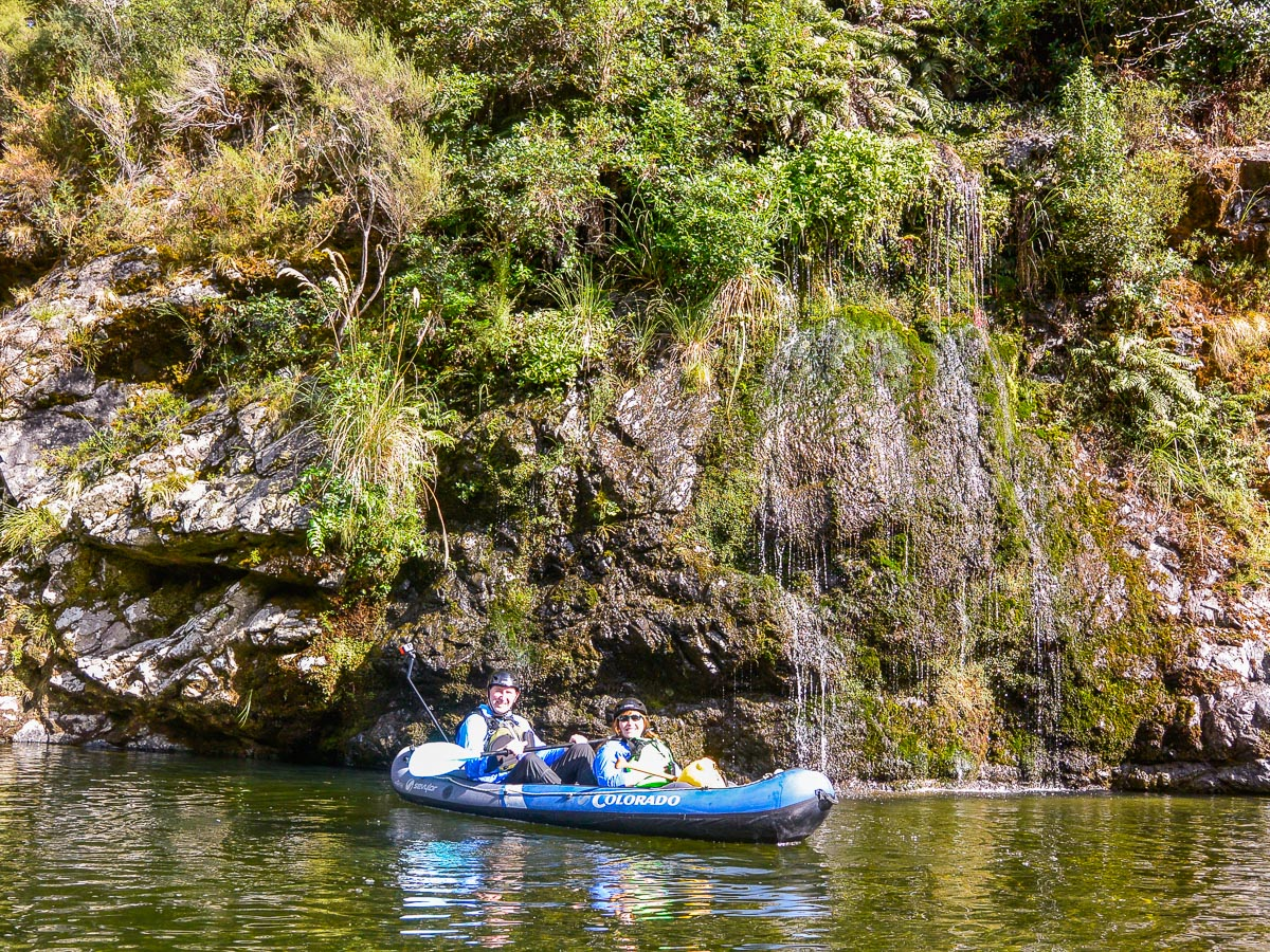 Couple kayaking at Pelorus river's falls