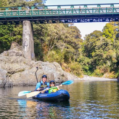 Couple kayaking at the Pelorus river, Havelock