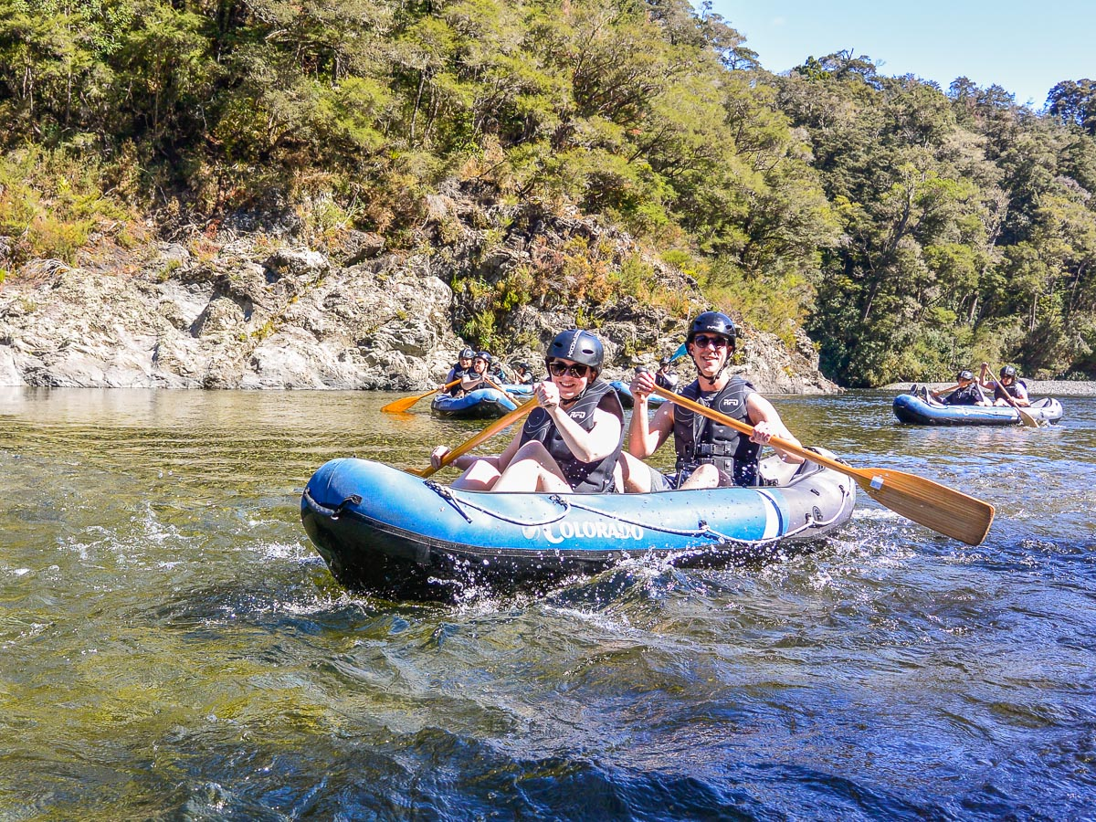 Happy couple kayaking in Marlborough, NZ