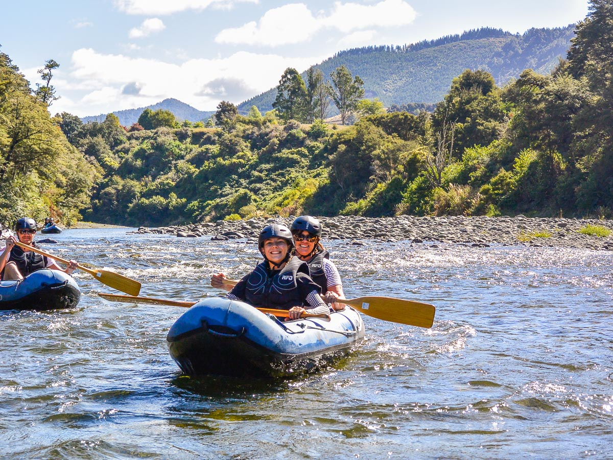 Happy friends kayaking in Marlborough, NZ