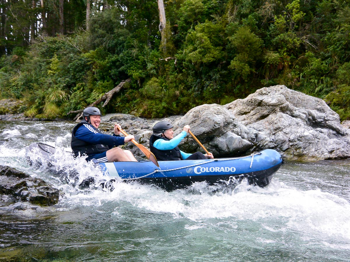 Happy couple kayaking in New Zealand