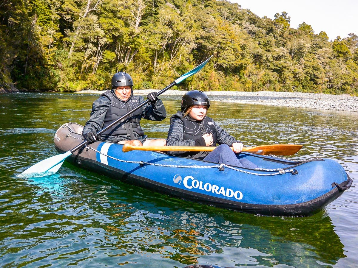Dad and son kayaking in New Zealand