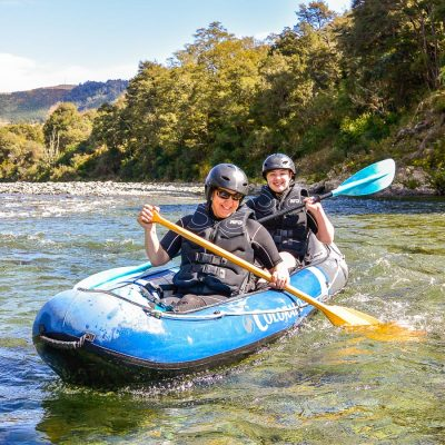 Happy kayakers in New Zealand