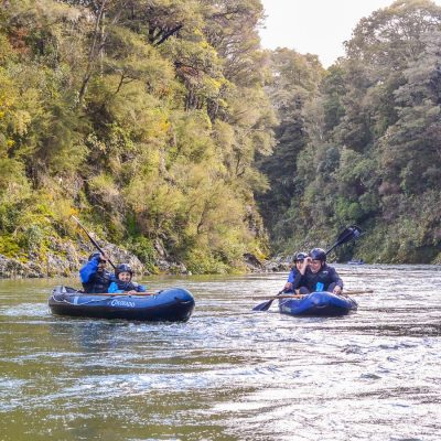 Group kayaking in New Zealand