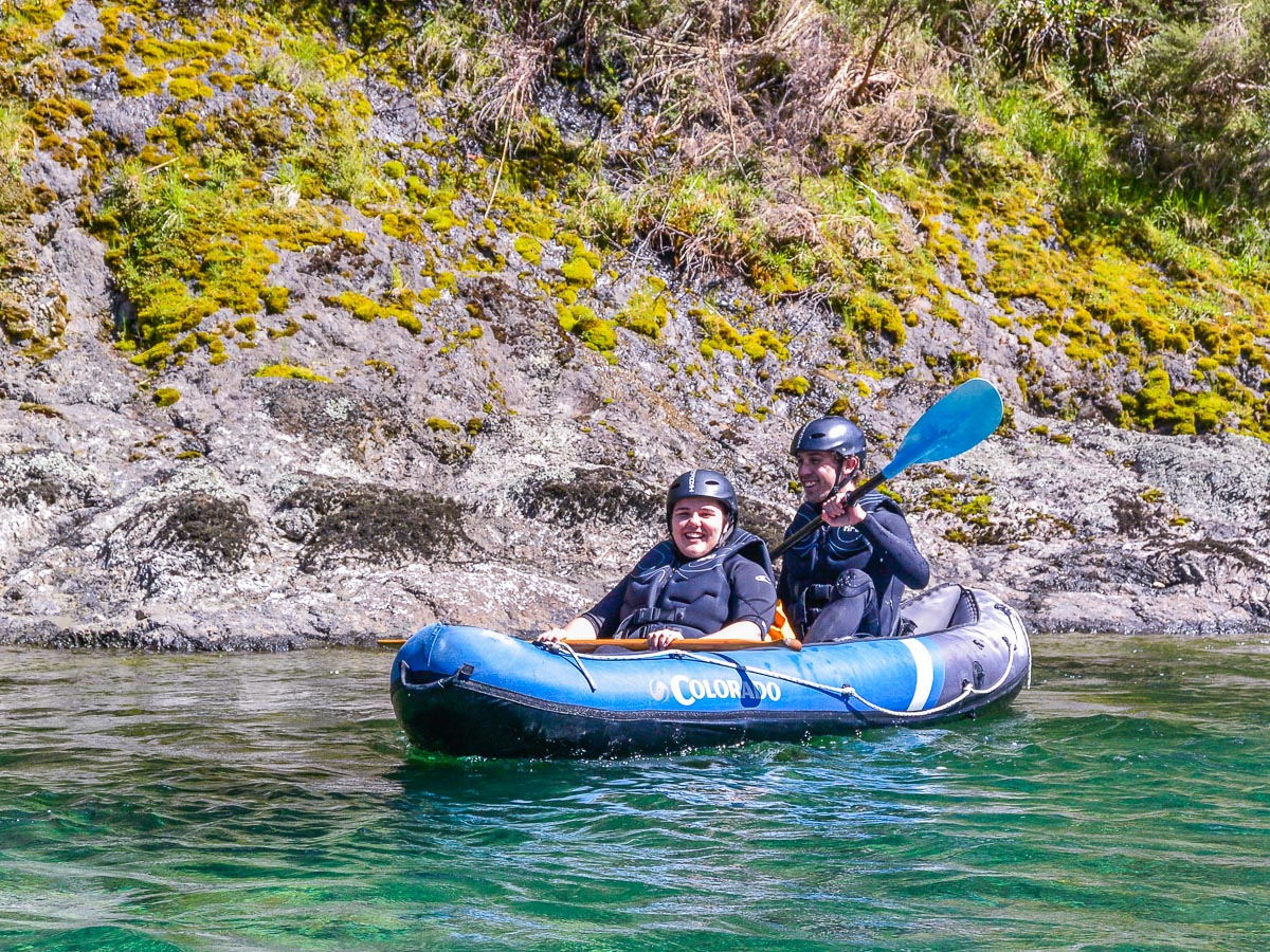 Happy couple kayaking at the Pelorus river